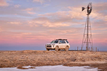 Nunn, CO, USA - March 28, 2021: Toyota 4Runner SUV (2016 Trail edition) in Pawnee National Grassland in northern Colorado, early spring scenery with a dusk sky.