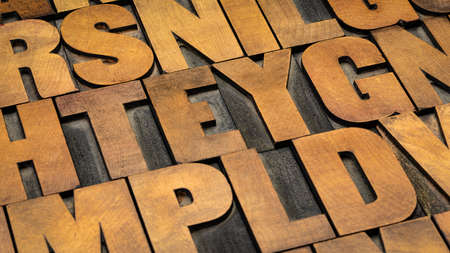 background of random vintage letterpress wood type printing blocks 版權商用圖片