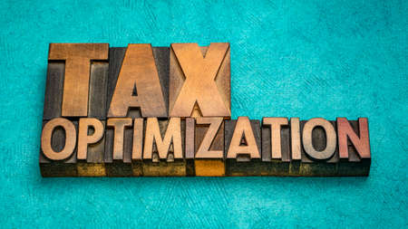 tax optimization, financial concept in vintage letterpress wood type, business and tax planning