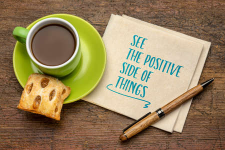 see the positive side of things  - inspirational handwriting on a napkin with a cup of coffee, positivity, mindset and personal development concept 版權商用圖片