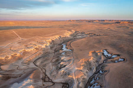 sunrise over badlands in Pawnee National Grassland in northern Colorado, early spring scenery, aerial view of Main Draw OHV Area