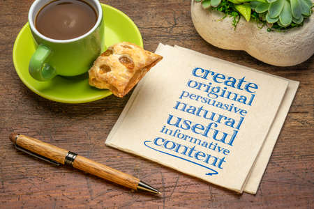 create original, persuasive, natural, useful, informative content - creating content advice - handwriting on napkin with cup of coffee 版權商用圖片