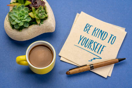 be kind to yourself - inspirational handwriting on a napkin with a cup of coffee, self care concept