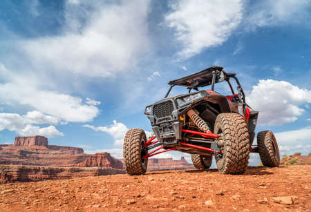 MOAB, UT, USA - MAY 7, 2017: Polaris RZR ATV on a popular Chicken Corner 4WD trail in the Moab area.