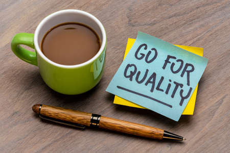 go for quality reminder note with a cup of coffee and pen, business, lifestyle and personal development concept