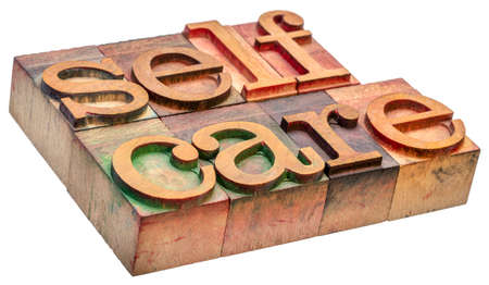 self care - isolated word abstract in vintage letterpress wood type - mental, emotional, and physical health concept