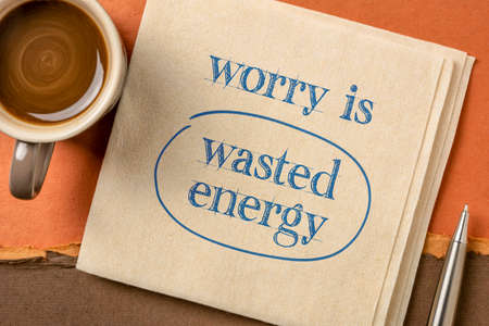 worry is wasted energy - inspirational handwriting on a napkin with a cup of coffee, positive mindset and optimism concept Archivio Fotografico