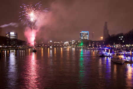 The Weser in the evening with fireworks during the Advent season