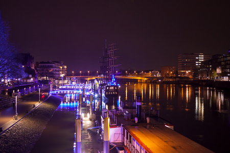 The Weser in the evening with lights and ships in Advent