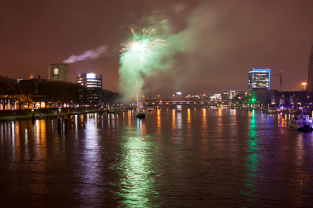 The Weser in the evening with fireworks over the water during the Advent season Stock Photo