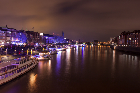 The Weser in the evening for Christmas with Christmas lights