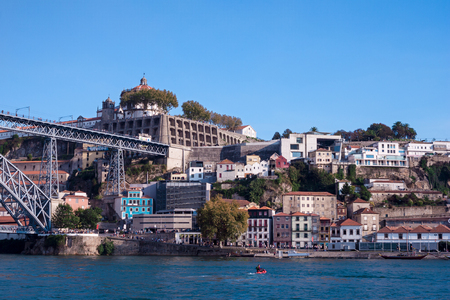 View over the river Douro in Porto, in the background the famous bridge and part of the old town