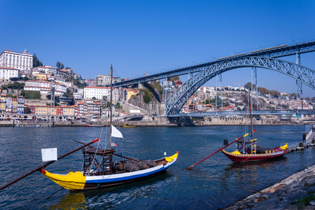 View over the river Douro in Porto, in the foreground ships, in the background the famous bridge