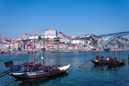 View over the Douro river in Porto with views of the city and the famous bridge