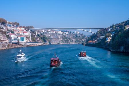 View over the river Douro in Porto, in the background a bridge