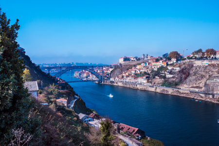 View over the river Douro in Porto, in the background the famous bridge and the skyline