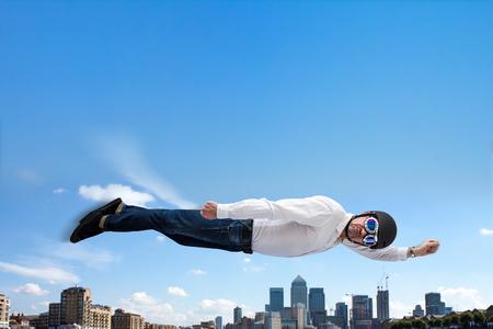 Superhero flies over London