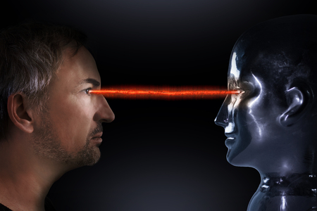 Man and robot connect through a red beam of light Stock Photo