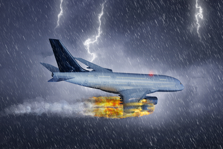Passenger airplane flies with burning engine in a heavy storm