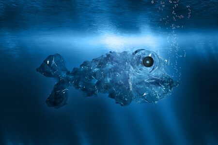 Plastic garbage in the form of a fish floats underwater in the ocean
