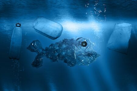 Plastic garbage in the shape of a fish floats underwater in the ocean surrounded by other plastic garbage