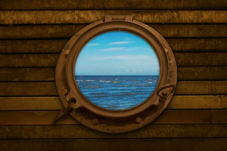 Looking through a porthole at the open sea