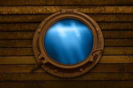 Looking through a porthole into the depths of the sea Фото со стока