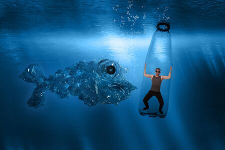 A man is trapped under water in a plastic bottle and a huge plastic fish approaches him