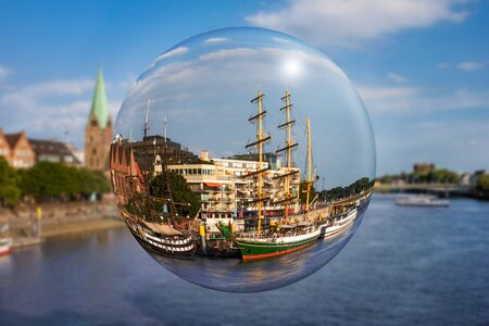 View on Weser promenade through a glass ball