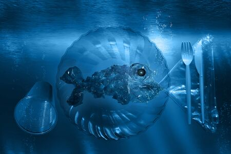 Plastic fish on plastic dishes with plastic cutlery under water Zdjęcie Seryjne