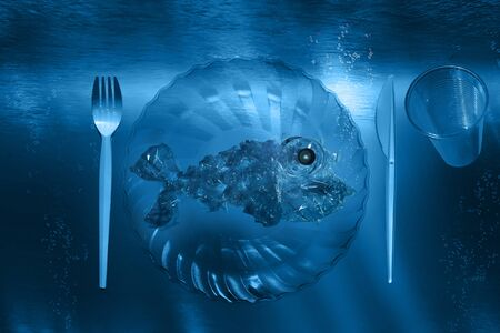 Plastic fish on plastic service with plastic cutlery under water Stock fotó
