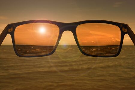 Sunglasses before sunset, sharpness is visible only in the lenses