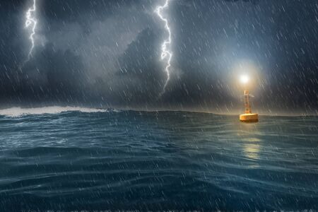 A yellow buoy drifts in rough sea in a storm Stock fotó