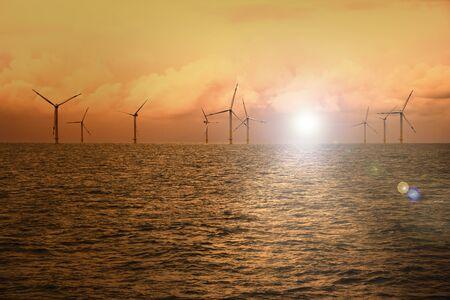 Wind turbines on the high seas at dusk Reklamní fotografie