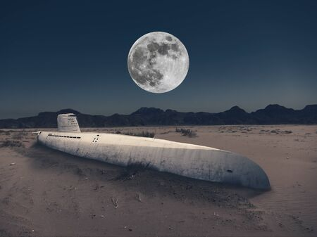 An old submarine is stuck in the sand of the desert at night