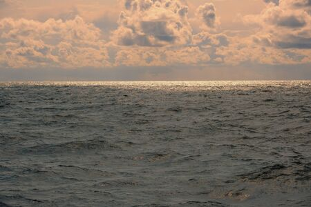 The open sea with waves and a dramatic sky