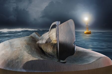 A ship lies with its keel up in the sea during twilight and the propeller is still turning. A buoy is floating in the background.