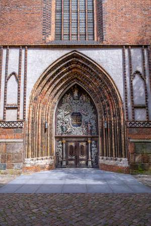 Elaborately decorated church door in Stralsund