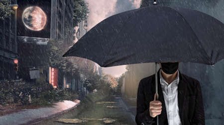 A man with a face mask and an umbrella in front of an end times backdrop