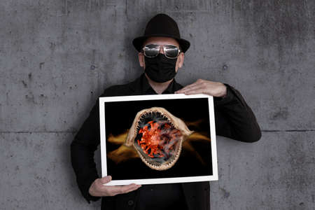A man carries a picture frame in which a virus can be seen