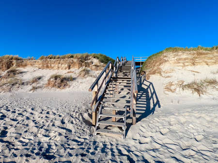 A dune on the island of Sylt with a wooden staircase Archivio Fotografico
