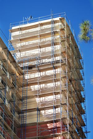 Building wrapped in Scaffold Stock Photo
