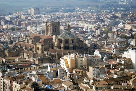 Cathedral in Granada located in Southern portion of Spain.  Picture taken from the Alhambra on the lower slopes of the Sierra Nevada 写真素材