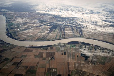 Aerial view of the old, mighty Mississippi River running through Louisiana farmland on a cold wet winters day. Stock Photo