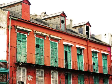 disrepair: Green Storm Shutters ravaged due to weathering storms in French Quarter in New Orleans, Louisiana (NOLA).