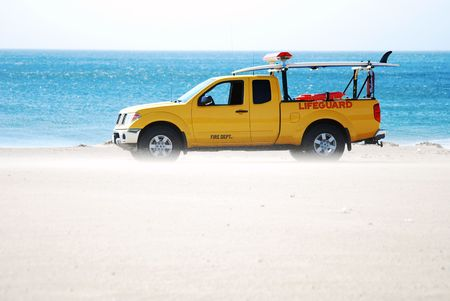 sandblasted: Lifeguard truck gets sandblasted by strong Santa Ana winds in sunny Southern California.