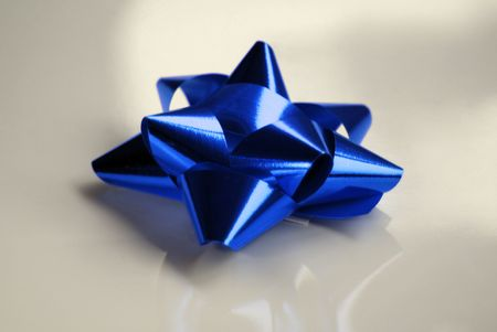 contrasted: Blue bow isolated and contrasted over silver background.
