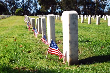 Tombstones lined up in the Los Angeles National Cemetery. The VA National Cemetery Administration honors the military service of our Nations veterans. Stock Photo