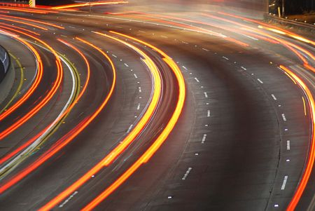 Vehicles streaking down the 101 Freeway at rush hour in Los Angeles, California. photo