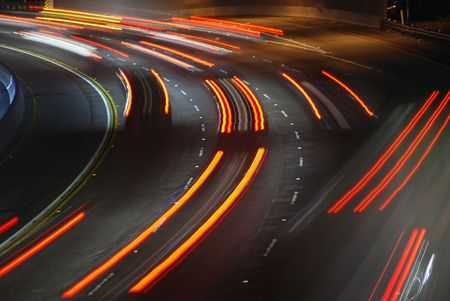 Vehicles streaking down the 101 Freeway at rush hour in Los Angeles, California. Stock Photo